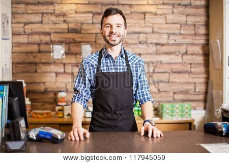 Business Owner At The Checkout Counter