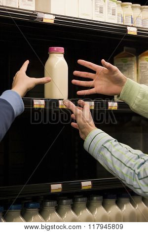 People reaching for milk