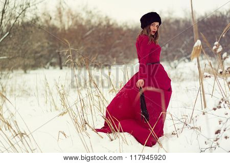 Beautiful Woman In Winter Field