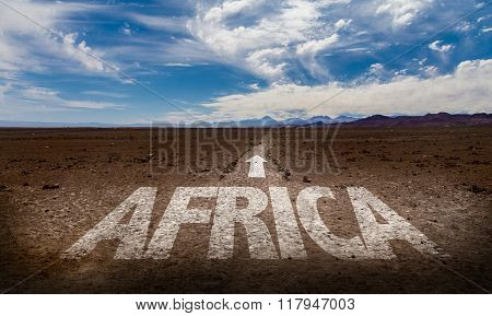 Africa written on desert road