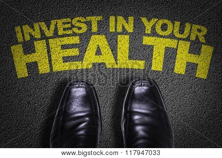 Top View of Business Shoes on the floor with the text: Invest In Your Health