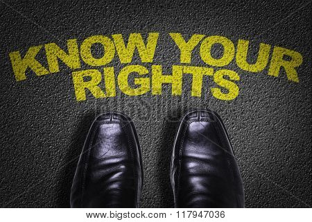 Top View of Business Shoes on the floor with the text: Know Your Rights