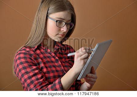teen girl using tablet computer shoot in studio