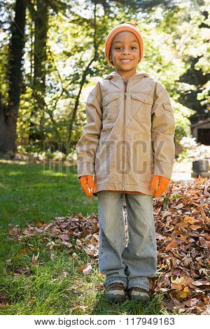 Boy in garden in autumn