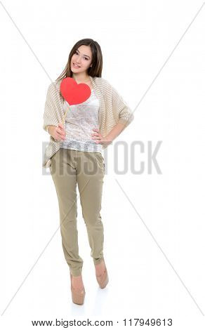 Full length portrait of attractive happy smiling teen girl with red heart, love holiday valentine symbol over white background