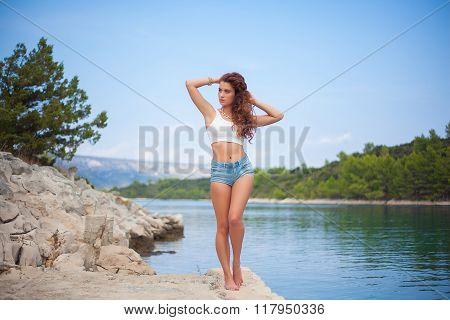 Sexy Girl In Jean Shorts On Sea Beach