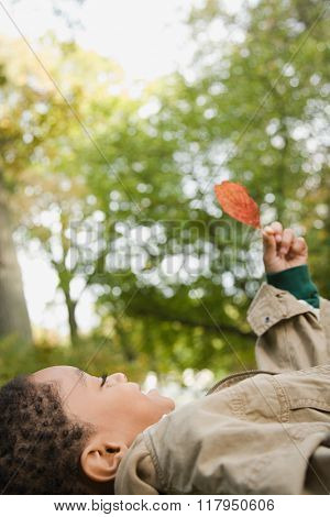 Boy holding a leaf
