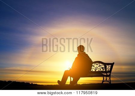 The Lonely Man Sits On A Decline