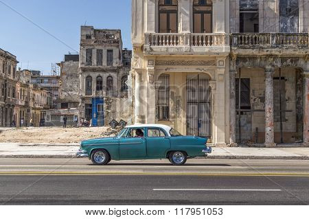 Green car on the Havana Malecon