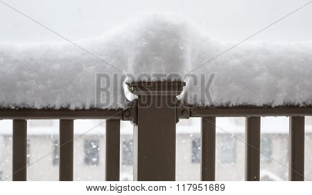 Snow Piled High On Railing Of Balcony