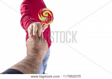 Man Hand Give Candy To Child