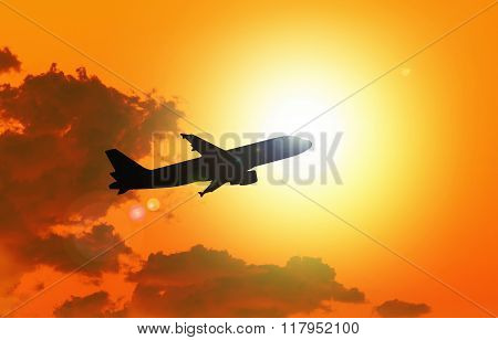 Silhouette Of An  Airplane Taking Off , Sunset Evening Sky.