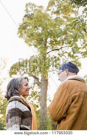 Mature couple near a tree