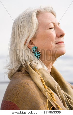 Serene looking gray haired woman