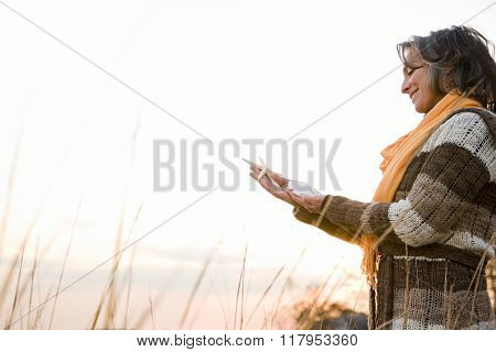 Mature woman holding a starfish