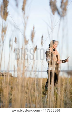 Mature woman standing on a marsh