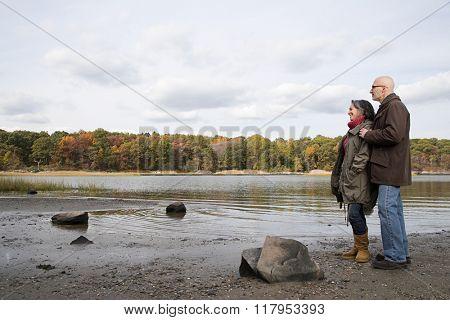 Mature couple looking at a lake