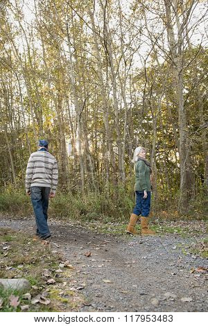 Mature couple walking in a forest