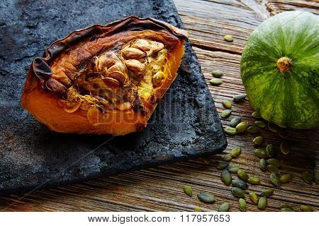 roasted pumpkin on vintage tray in wooden table background