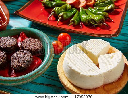 Tapas Morcilla and cheese de Burgos from Spain and padron peppers