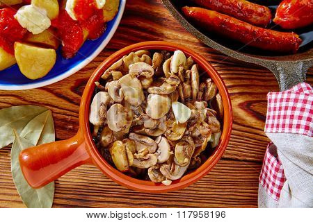 Tapas from Spain champinones mushrooms with potatoes and sausage