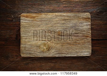 Aged wood cutting board as a copyspace background for any theme message