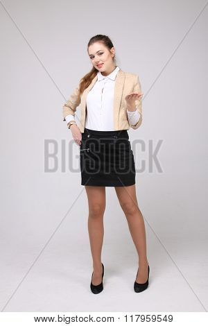 smiling young business woman showing blank area