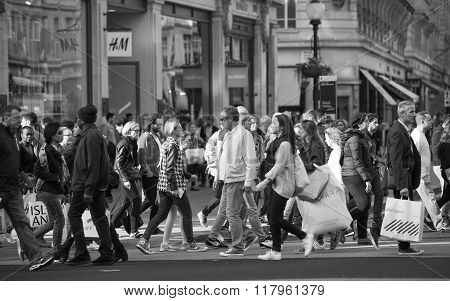 Crowd of people crossing the road on the Regent street. london