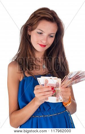 Young smiling woman with freckles holds cash