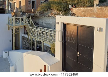 SANTORINI, GREECE - AUGUST 07, 2015: building details on Santorini island. The traditional architecture of Santorini is similar to that of the other Cyclades, with low-lying cubical houses