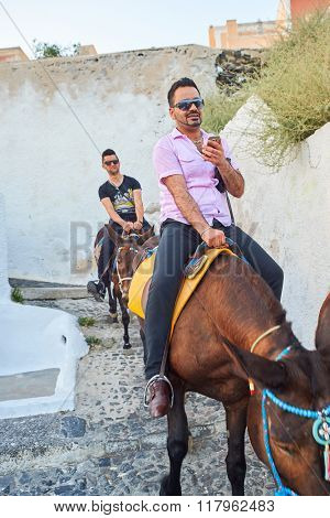 SANTORINI, GREECE - AUGUST 07, 2015: people on streets of Santorini island. Santorini, classically Thera, and officially Thira, is an island in the southern Aegean Sea