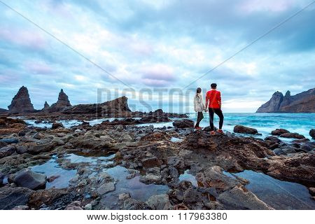 Couple on the rocky coast