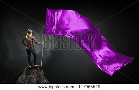 Woman with purple waving flag