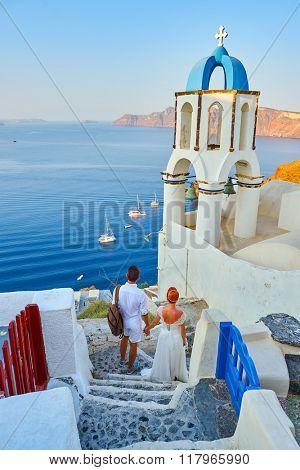 Beautiful young couple bride and groom celebrate wedding on Santorini