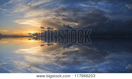 Large Vibrant Panorama Image Of Stormy Sunset Sky With Reflection In Water