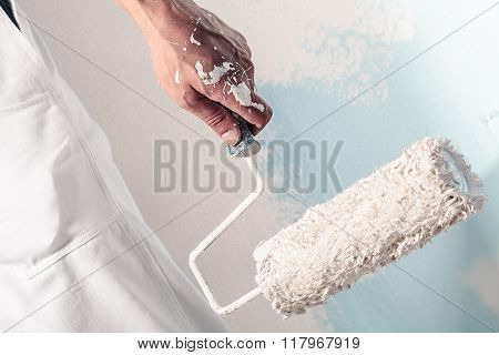 Workman Hand Holding Dirty Paintroller