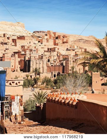 Ksar of Ait-Ben-Haddou in  the morning, Morocco. View from shopping street. Focus on the background.