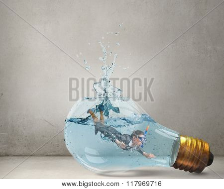 Businesswoman jumping in water