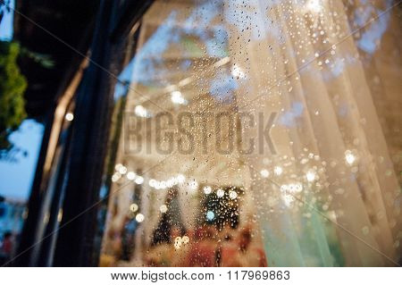 raindrops on the glass with the Edison's lamps