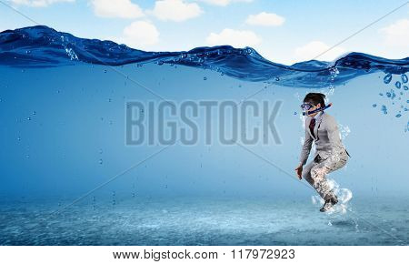 Diving in water businessman