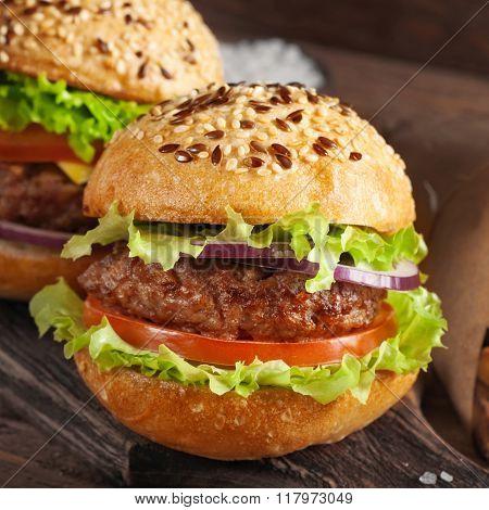 Burger On Wooden Background Closeup