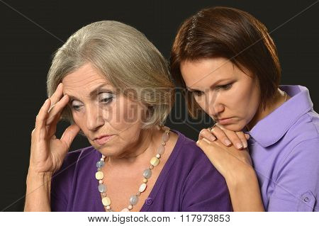 sad Senior woman with daughter