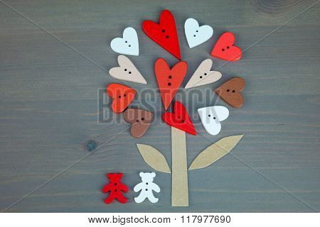 Post card for the Valentine. Button love. Wooden buttons. Button love tree and two bears on grey woo