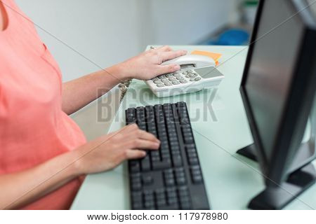 Pregnant woman using computer on a desk