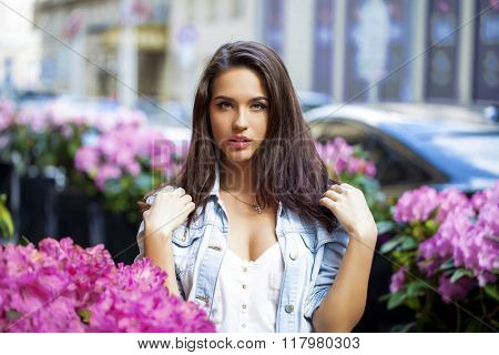 Portrait of a young woman on spring street