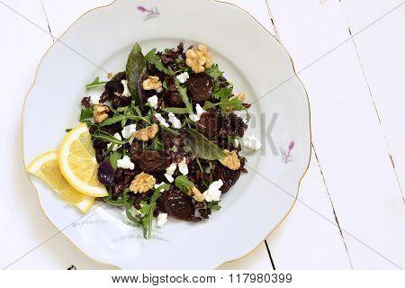 Black rice, arugula, sun-dried plums, walnuts and feta, salad