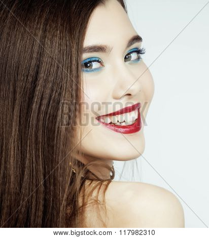 young pretty brunette woman with hair on face sexual seduction close up