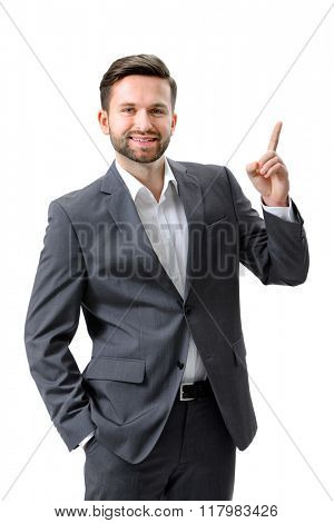 Handsome young businessman pointing to something