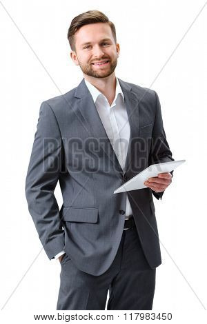 Portrait of a young man with a digital tablet isolated on white background