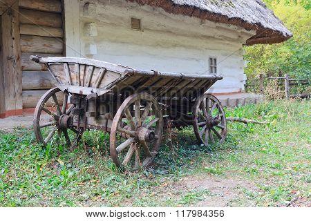 Ancient Wagon Ukrainian Peasants Near The House. Pirogovo, Ukraine